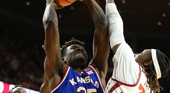 Kansas center Udoka Azubuike (35) bangs inside for a bucket and a foul from Iowa State forward Solomon Young (33) during the first half, Tuesday, Feb. 13, 2018 at Hilton Coliseum in Ames, Iowa. In back is Iowa State forward Cameron Lard (2).