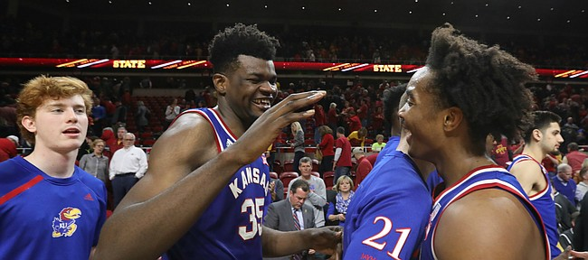 Kansas center Udoka Azubuike (35) smiles as he meets Kansas guard Devonte' Graham (4) in the handshake line following the Jayhawks' 83-77 win over Iowa State, Tuesday, Feb. 13, 2018 at Hilton Coliseum in Ames, Iowa. Graham went two of five from the free throw line in the final minutes.