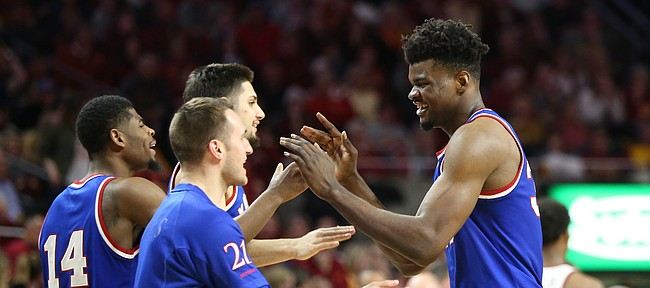 Kansas center Udoka Azubuike, right, is congratulated by his teammates after a string of buckets during the second half, Tuesday, Feb. 13, 2018 at Hilton Coliseum in Ames, Iowa.