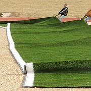 In this file photo from Jan. 6, 2009, artificial turf is installed at the Free State High School football field.
