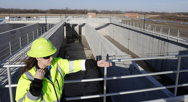 Melinda Harger, utilities engineer with the City of Lawrence, stands above the Biological Nutrient Removal basin at the new Wakarusa Wastewater Treatment Plant, 2300 E. 41st St., Tuesday, Feb. 13, 2018.