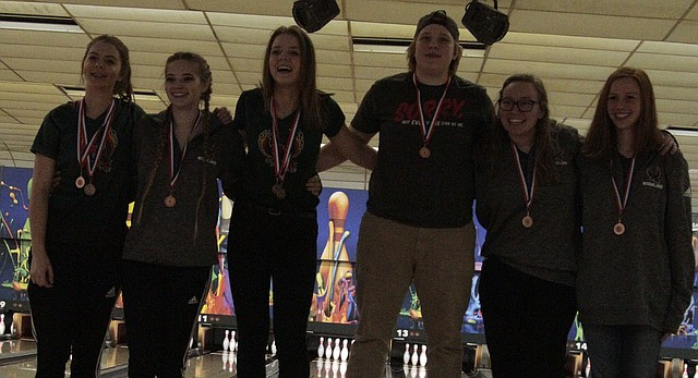 Free State's girls bowling team stands on the awards podium after its third-place finish at the Sunflower League meet on Tuesday at Mission Bowl 'N Olathe. Pictured from left: Lexie Lockwood, Sydney Jordan, Nikki Miele, Sapphie Knight, Gabbie McCurdy and Raegan Finkeldei.