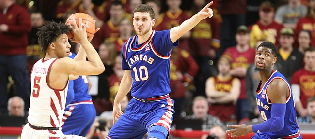 Kansas guard Sviatoslav Mykhailiuk (10) directs his teammates on defense as he guards Iowa State guard Lindell Wigginton (5) during the first half, Tuesday, Feb. 13, 2018 at Hilton Coliseum in Ames, Iowa. At right is Kansas guard Malik Newman (14).