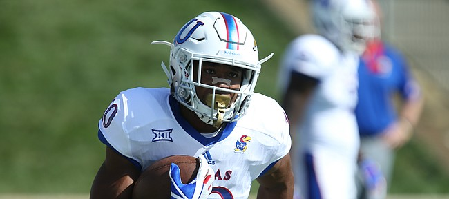 Kansas running back Khalil Herbert (10) fields a kickoff during warmups on Saturday, Sept. 16, 2017 at Peden Stadium in Athens, Ohio.