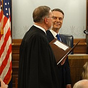 Tracey Mann, right, is sworn into office Wednesday to become the 50th lieutenant governor of Kansas as Kansas Supreme Court Chief Justice Lawton Nuss, left, administers the oath and Gov. Jeff Colyer looks on.
