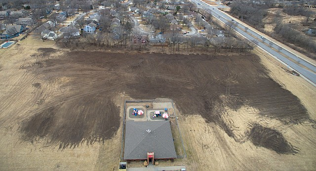 A third of a nine-acre plot of land at the southwest intersection of Clinton Parkway and Crestline Drive has recently been bulldozed. The land is pictured, Thursday, Feb. 15, 2018.