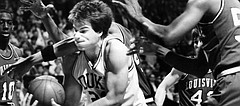 Jay Bilas, center, of Duke is surrounded by Louisville players as he struggles to keep the ball during the first half of the NCAA Championship game at Reunion Arena in Dallas, April 1, 1986. (AP Photo/Ron Heflin)