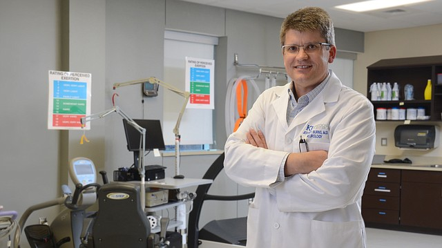 Dr. Jeffrey Burns is shown in the exercise lab at the University of Kansas Alzheimer's Disease Center. Burns, co-director of the center, is a co-principal investigator on a study called IGNITE, or Investigating Gains in Neurocognition in an Intervention Trial of Exercise.