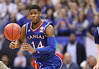 Kansas guard Malik Newman (14) comes away with a  ball from West Virginia forward Logan Routt (31) during the first half, Saturday, Feb. 17, 2018 at Allen Fieldhouse.