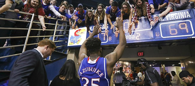 Kansas center Udoka Azubuike (35) reaches to high five the students as he leaves the court following the Jayhawks' 77-69 win over the Mountaineers, Saturday, Feb. 17, 2018 at Allen Fieldhouse.