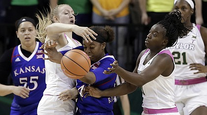 Baylor's Lauren Cox, left, and Dekeiya Cohen, right, combine to strip the ball away from Kansas' Austin Richardson, center, in the second half of an NCAA college basketball game Saturday, Feb. 17, 2018, in Waco, Texas. (AP Photo/Tony Gutierrez)