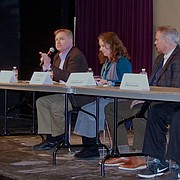 Bob Tryanski, left, Douglas County director of behavioral heath projects, speaks at a panel discussion Saturday at the Lawrence Arts Center on the referendum the Douglas County Commission has advanced that would authorize a half-cent sales tax for the expansion of the county jail and behavioral health initiatives. Also on the panel, from left, were Joanna Harader, of Justice Matters; Mike Brouwer, director the Douglas County Jail re-entry program; Patrick Wilbur, of the Lawrence Sunset Alliance; and Douglas County Commission Chair Nancy Thellman.