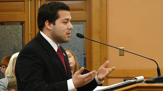 Eric Martinez, government relations director for the University of Kansas Student Senate, testifies before a House committee opposing a bill to repeal a law that allows certain undocumented immigrants in Kansas to pay in-state tuition at state colleges and universities.