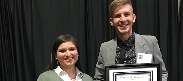 Berenice Weisel, therapeutic classroom teacher at Southwest Middle School, and Brandon Daley, a fifth-grade teacher a Woodlawn Elementary, receive Horizon Awards at a Kansas State Department of Education ceremony Friday in Topeka recognizing exemplary first-year teachers.