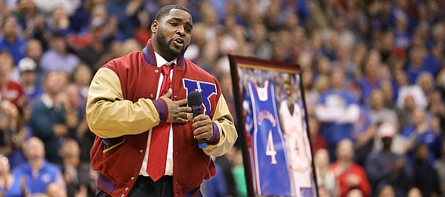 Former Kansas guard Sherron Collins thanks various people during a halftime ceremony retiring his jersey , Monday, Feb. 19, 2018 at Allen Fieldhouse.