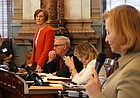 Sen. Caryn Tyson, front, R-Parker, defends a bill that restores a tax break for small businesses while Sen. Barbara Bollier, R-Mission Hills, argues for sending it back to committee.