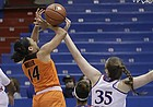 Kansas center Bailey Helgren (35), right, blocks a shot in the Jayhawks' home game against Oklahoma State at Allen Fieldhouse on Wednesday.