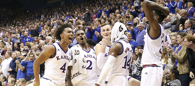 The Kansas bench celebrates a dunk in the final minutes by Kansas guard Sam Cunliffe (3) during the second half of their 104-74 win against Oklahoma on Monday, Feb. 19, 2018 at Allen Fieldhouse.