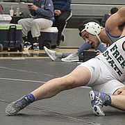 Free State senior Elijah Denmark tries to gain control of his match against Olathe South's Kolby Murphy during the Firebirds double dual against the Falcons and Olathe Northwest on Thursday at FSHS.