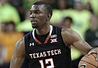 Texas Tech guard Keenan Evans (12) handles the ball during an NCAA basketball game against Baylor on Saturday, Feb. 17, 2018, in Waco, Texas. (AP Photo/Tony Gutierrez)