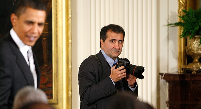 Pete Souza, White House Photographer, works as President Barack Obama greets guests after he signed an executive order for the White House Initiative on Historically Black Colleges and University in the East Room of the White House in Washington Friday, Feb. 26, 2010. (AP Photo/Charles Dharapak)