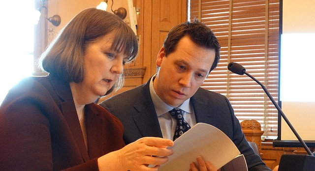 Lori Taylor, a professor and researcher at Texas A&M University, and Jason Willis of the nonprofit education consulting firm WestEd, review notes before briefing Kansas lawmakers Feb. 23, 2018, on the study they are performing to determine how much it will cost to comply with a Kansas Supreme Court mandate to provide adequate funding fo Kansas public schools.