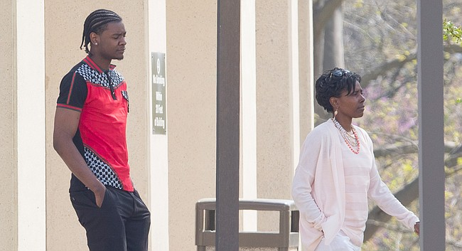 In this file photo from April 12, 2017, former University of Kansas basketball player Josh Jackson and his mother, Apples Jones, are pictured outside of the Douglas County Courthouse.