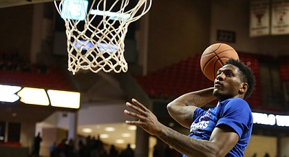 Kansas freshman Silvio De Sousa gets up for a pre-game dunk at Texas Tech, on Feb. 24, 2018.