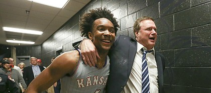 Kansas guard Devonte' Graham (4) and Kansas head coach Bill Self walk arm in arm down the hallway to the locker room following the Jayhawks' 74-72 win over Texas Tech on Saturday, Feb. 24, 2018 at United Supermarkets Arena.