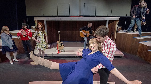 """Sicily Rees and Alan Martin, center foreground, join an ensemble cast during rehearsals of Theatre Lawrence's production of """"Ring of Fire."""" In the background, from left, are cast members Chelsea Watgen, Ryan Nichols, Julia Peterson, Russ Baker, Chris Hatfield and Katherine Bettis. The production opens March 2."""