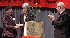 In this file photo from May 2006, Kansas Gov. Kathleen Sebelius shakes the hand of Wu Qidi, vice minister in China's Ministry of Education, while University of Kansas Chancellor Robert Hemenway applauds during opening ceremonies for the Confucius Institute at KU's Edwards Campus in Overland Park.