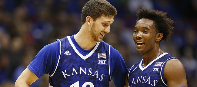 Kansas guards Sviatoslav Mykhailiuk (10) and Devonte' Graham (4) make conversation during the second half, Friday, Nov. 18, 2016 at Allen Fieldhouse.