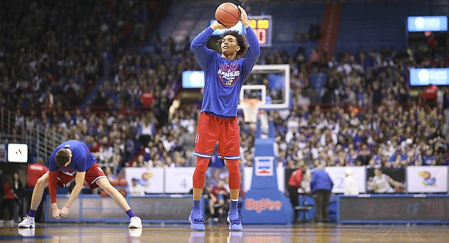 Kansas senior Devonte' Graham throws up a shot prior to his final home game at Allen Fieldhouse on Feb. 26, 2018. The Jayhawks will play Texas.