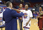 Kansas forward Chayla Cheadle hugs coach Brandon Schneider during the senior recognition on Tuesday, Feb. 27, 2018. Iowa State outscored KU 65-56.