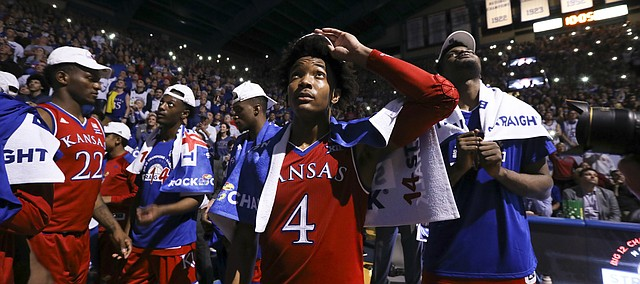 Kansas guard Devonte' Graham (4) watches a highlight video with his teammates following their 80-70 win over Texas on Monday, Feb. 26, 2018 at Allen Fieldhouse. The win gave the Jayhawks an outright win of their 14th-straight Big 12 Conference title.