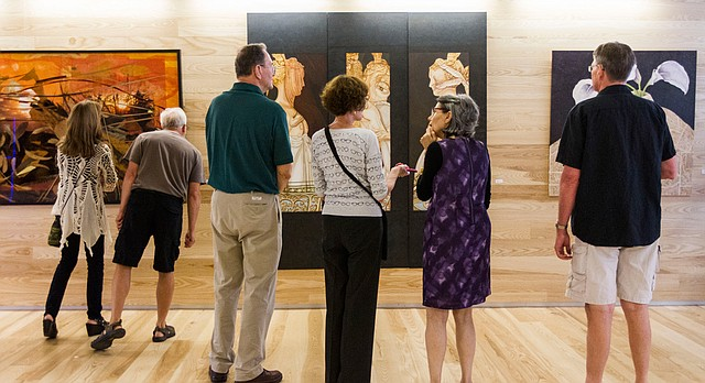 In this file photo from August 2014, patrons view art during a Final Fridays event at the Lawrence Public Library.