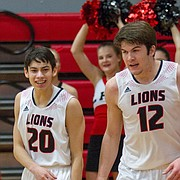 Lawrence High player Clarence King (3) celebrates with teammates Brett Chapple (12) and Jake Rajewski (20) after taking over the game late in the 4th quarter on Wednesday, Feb. 28, 2018. LHS won 64-55.