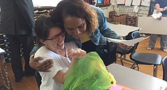 Cari Davis, an English for Speakers of Other Languages (ESOL) teacher at Liberty Memorial Central Middle School, receives a hug from interim Superintendent Anna Stubblefield, right, after being surprised with the Lawrence district's 2018 Secondary Teacher of the Year award on Thursday, March 1, 2018. Davis, who has taught in the district since 2006, also received a $1,000 check during Thursday's ceremony at Liberty.