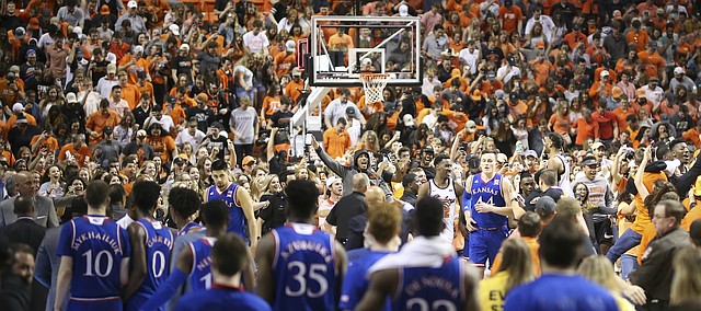 Kansas forward Mitch Lightfoot (44) wades through the masses of screaming Oklahoma State players and fans following the Cowboys' 82-64 win over the Jayhawks on Saturday, March 3, 2018 at Gallagher-Iba Arena, in Stillwater, Okla.
