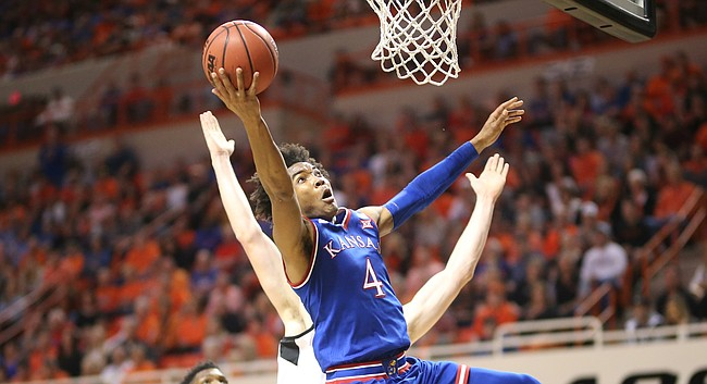 Kansas guard Devonte' Graham (4) is taken off balance on a shot during the first half, Saturday, March 3, 2018 at Gallagher-Iba Arena, in Stillwater, Okla.
