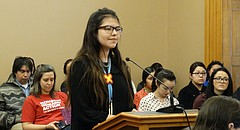 Georgia Blackwood, an eighth grade student at South Middle School in Lawrence, testifies before a Kansas Senate committee in support of a bill that prohibit state agencies and local governments from barring Native Americans from wearing their tribal regalia and other objects of cultural significance at public events, including graduations.