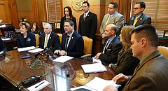 Kansas House Speaker Ron Ryckman, center, and other House Republicans unveil what they are calling a comprehensive plan to improve school safety in Kansas. The package calls for statewide standards to be developed by the Kansas State Board of Education, and it includes funding for building safety upgrades, but no new regulations on gun ownership or sales.