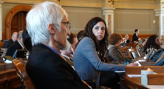 Reps. Boog Highberger and Eileen Horn, both Lawrence Democrats, listen during debate on the House floor on a bill to restore teacher tenure rights that lawmakers repealed in 2014.