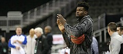Kansas center Udoka Azubuike (35) applauds his teammates from the sidelines during a shoot around on Wednesday, March 7, 2018 at Sprint Center in Kansas City, Mo.