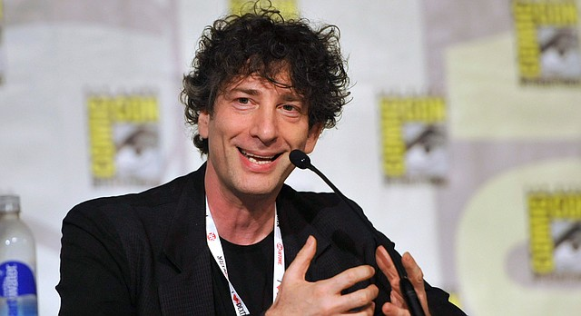 This July 21, 2013 file photo shows Neil Gaiman speaking at the Spotlight on Neil Gaiman panel on Day 5 of Comic-Con International in San Diego. (Photo by Chris Pizzello/Invision/AP, File)