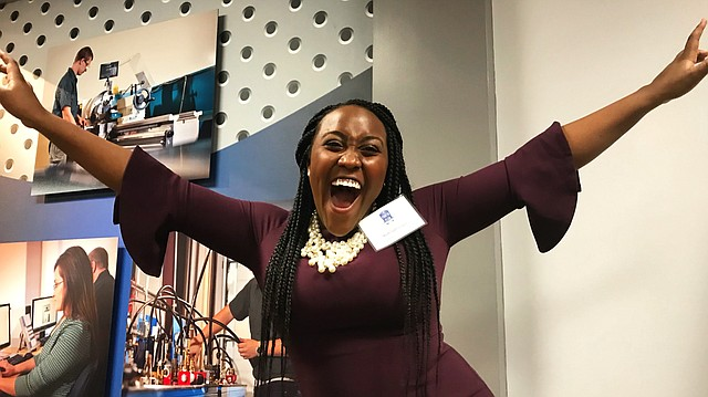Ruth Gathunguri, a junior at Free State High School, celebrates being named the Boys & Girls Club Kansas Youth of the Year Wednesday, March 7, 2018 at the Washburn Institute of Technology campus.