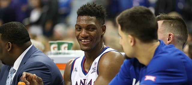 Kansas forward Silvio De Sousa (22) laughs on the bench with his teammates during the second half, Thursday, March 8, 2018 at Sprint Center in Kansas City, Mo.