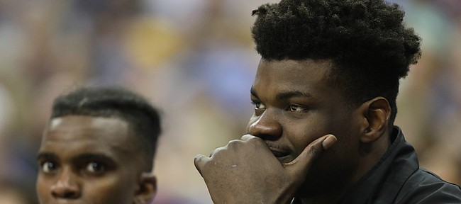 Injured Kansas center Udoka Azubuike watches from the bench during the second half, Friday, March 9, 2018 at Sprint Center in Kansas City, Mo.