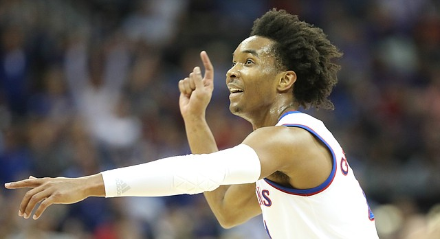 Kansas guard Devonte' Graham (4) looks for a shot to fall during the first half, Thursday, March 8, 2018 at Sprint Center in Kansas City, Mo.