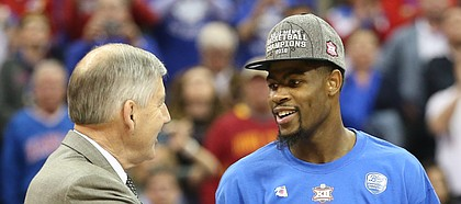 Kansas guard Malik Newman (14) is presented with the Big 12 Tournament MVP trophy by commissioner Bob Bowlsby following the Jayhawks' win.